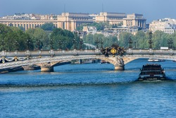 The picturesque embankments of the Seine River and Alexandre III bridge. Paris, France.