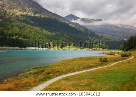 The picturesque lake in the Swiss Alps. Path along the shore