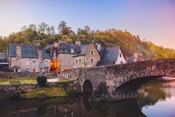 The picturesque medieval port of Dinan on the Rance Estuary, Brittany,France.The medieval city of Dinan in the setting sun, a popular tourist spot in France