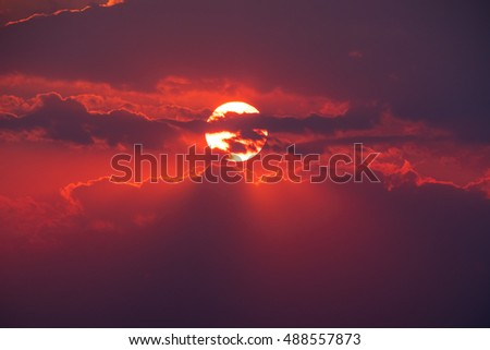 The picturesque red sunset with stormy cloud