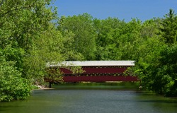 the picturesque sachs covered bridge over marsh creek on a sunny summer day, near gettysburg, pennsylvania