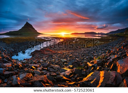 The picturesque sunset over landscapes and waterfalls. Kirkjufell mountain. Iceland