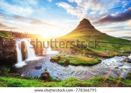 The picturesque sunset over landscapes and waterfalls. Kirkjufell mountain, Iceland.