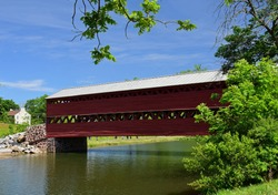 the picturesque, wooden,   red sachs covered bridge over marsch creek in adams county, near gettysburg, pennsylvania