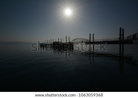 The pier of the ship pier to the pier in lake in sunny day.  #1063059368