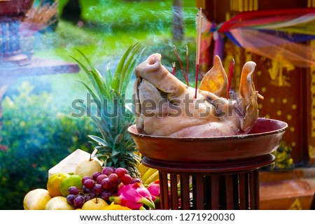 The pig's head sacrifice in the worship of house spirit in Asia tradition. #1271920030