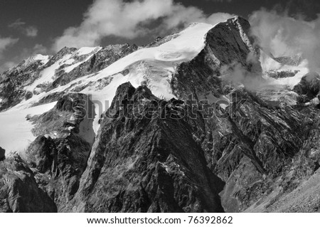 The Pigne d'Arolla and it's summit glacier in the swiss alps as seen from the east.