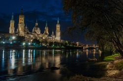 The Pilar of Zaragoza together river Ebro next to the stone bridge built by the Romans is the main tourist attraction of my city. It has been reformed for 7 centuries passing through various styles.
