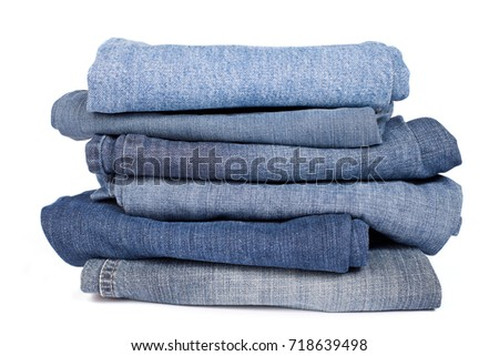 The pile of denim jeans pants, trousers #718639498