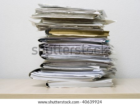The pile of documents lies on table