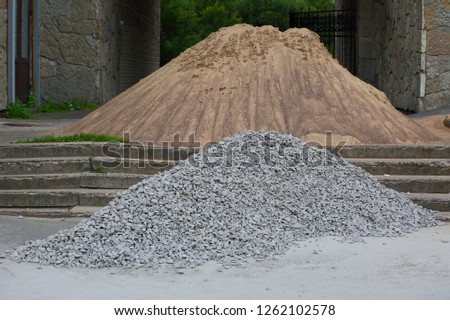 The pile of sand and pile of rubble