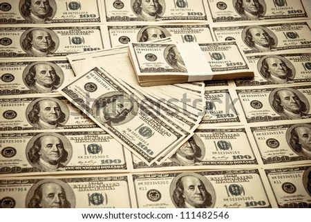 The pile of US federal reserve notes $100. Old style photo.