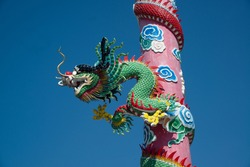 The pillars with stucco dragons wrapped around them are the art of Chinese shrines.