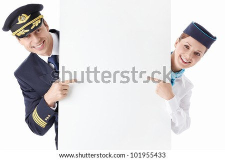 The pilot and flight attendant with a billboard