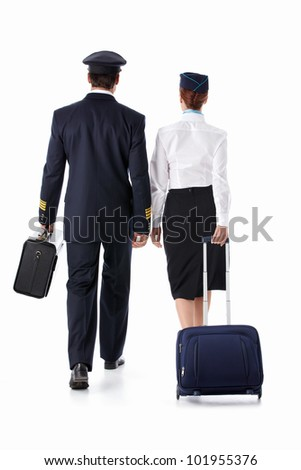 The pilot and flight attendant with a suitcase isolated