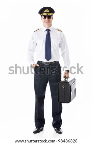 The pilot in sunglasses with a suitcase on a white background