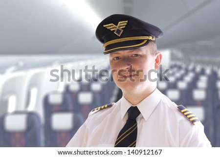 The pilot in the cabin waiting for passengers