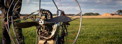 The pilot is preparing for flights a personal paralet with a gasoline engine. Paragliding for individual paragliding flights. Preparation for wing flight. Extreme sports. Small aircraft. Wide view