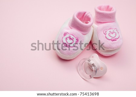 the pink baby shoes and pacifier