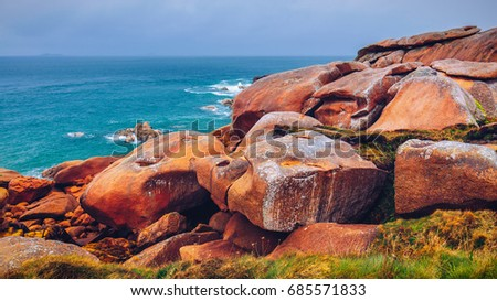 Shutterstock The pink granite coast view, granit rocks in Tregastel (Perros-Guirec), Brittany (Bretagne), France