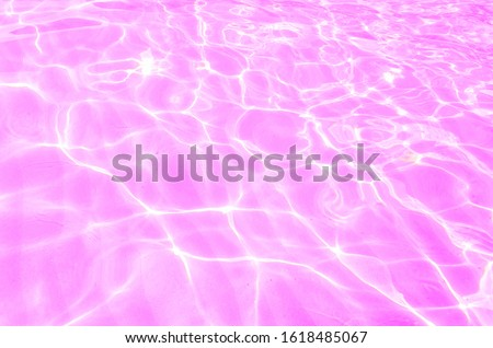 The pink water surface There's a flashing light from the sun.