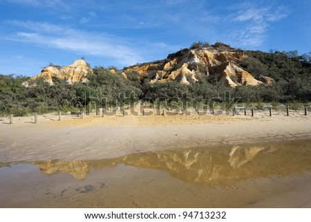 The Pinnacles at Fraser Island and the reflection of it in the foreground