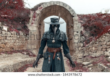The plague doctor at the cemetery gates Stockfoto ©