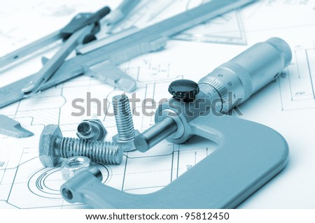 The plan industrial details, a screws, caliper, divider,micrometer. A photo closeup. Blue toning