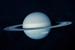 The planet Saturn, in blue tones among the stars. Elements of this image furnished by NASA