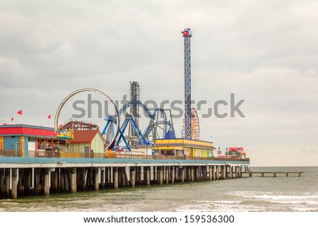The Pleasure Pier in Galveston Texas Pleasure Pier The Pleasure Pier attracts visitors to Galveston Island Texas