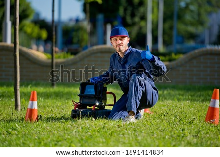 The plumber with portable camera for pipe inspection and other plumbing work. Stock photo ©
