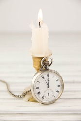 The  pocket watch and a candle
