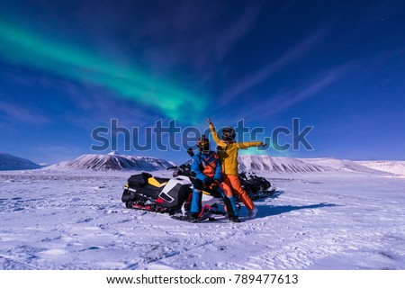 The polar arctic Northern lights aurora borealis sky star in Norway Svalbard in Longyearbyen city snowmobile the moon mountains - Shutterstock ID 789477613