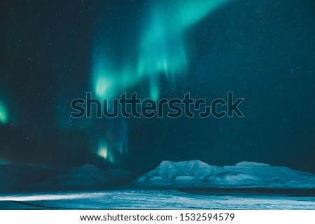 The polar arctic Northern lights hunting aurora borealis sky star in Norway travel photographer  Svalbard in Longyearbyen city the moon mountains Сток-фото ©