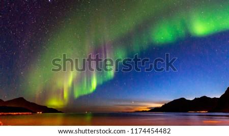 The polar lights in Norway. Tromso.Grotfjord Stock photo ©
