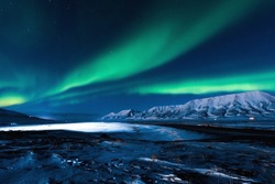 The polar Northern  lights in Norway Svalbard in the mountains