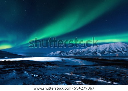 The polar Northern  lights in Norway Svalbard in the mountains #534279367