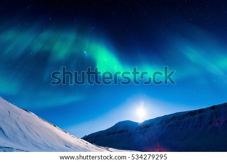 The polar Northern  lights in Norway Svalbard in the mountains moon #534279295