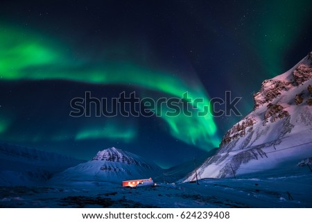 The polar Northern lights in the mountains house of Svalbard, Longyearbyen city, Spitsbergen, Norway wallpaper Сток-фото ©