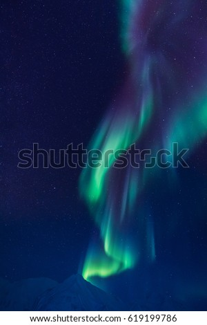 The polar Northern lights in the mountains of Svalbard, Longyearbyen, Spitsbergen, Norway wallpaper #619199786