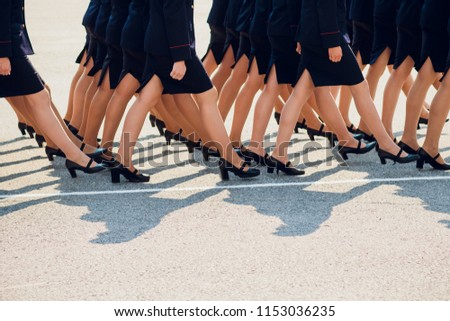 the police are marching. legs. shoes in line