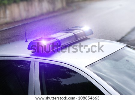 The police beacon on the car