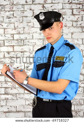 The policeman writes the report