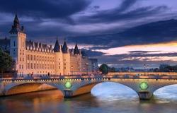 The Pont au Change, bridge over river Seine and the Conciergerie, a former royal palace and prison in Paris, France.