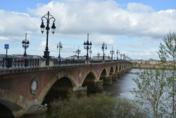 The Pont de pierre in Bordeaux France across natural river for help people's usual life day view
