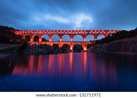 The Pont du Gard (Bridge of the Gard) is an ancient Roman aqueduct bridge that crosses the Gardon River in Vers-Pont-du-Gard near Remoulins, in the Gard d���©partement of southern France, Europe.
