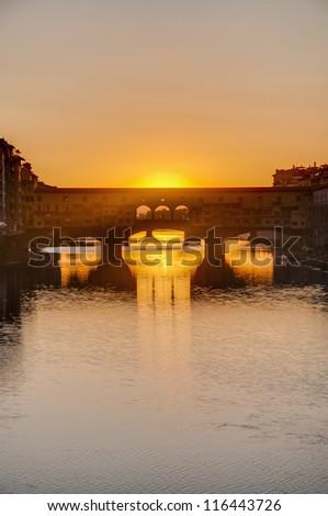 The Ponte Vecchio (Old Bridge), a Medieval stone closed-spandrel segmental arch bridge over the Arno River in Florence, Italy.