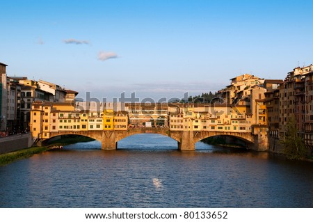 "The Ponte Vecchio (""Old Bridge"") is a Medieval bridge over the Arno River at evening. Florence, Tuscany, Italy."