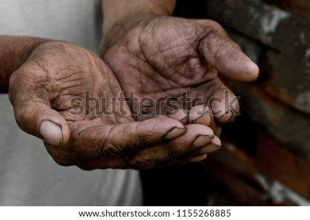 The poor old man's hands beg you for help. The concept of hunger or poverty. Selective focus. Poverty in retirement. Alms. Hypotrophy