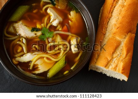 the popular comfort food of chicken noodle soup a favorite variety with crusty bread